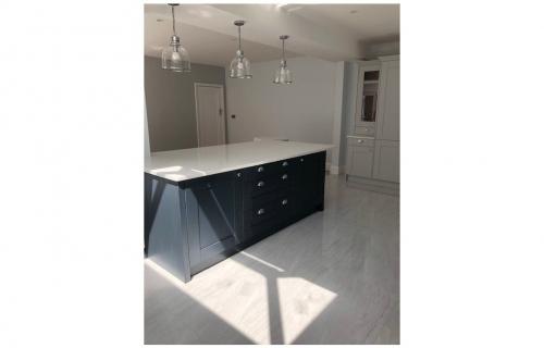 Wrap Around Extension features New Kitchen Installation & Roof Lanterns